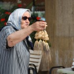 A woman selling woven wheat charms at the Corinth Canal.